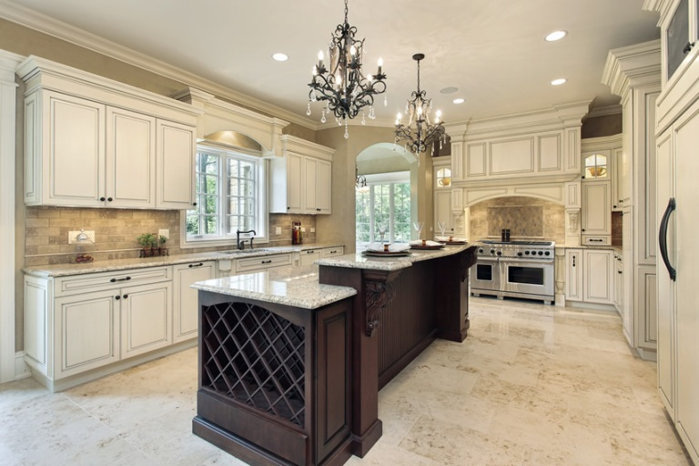 white-luxury-kitchen-with-granite-island-two-chandeliers